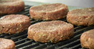 cooking hamburgers on a pellet grill